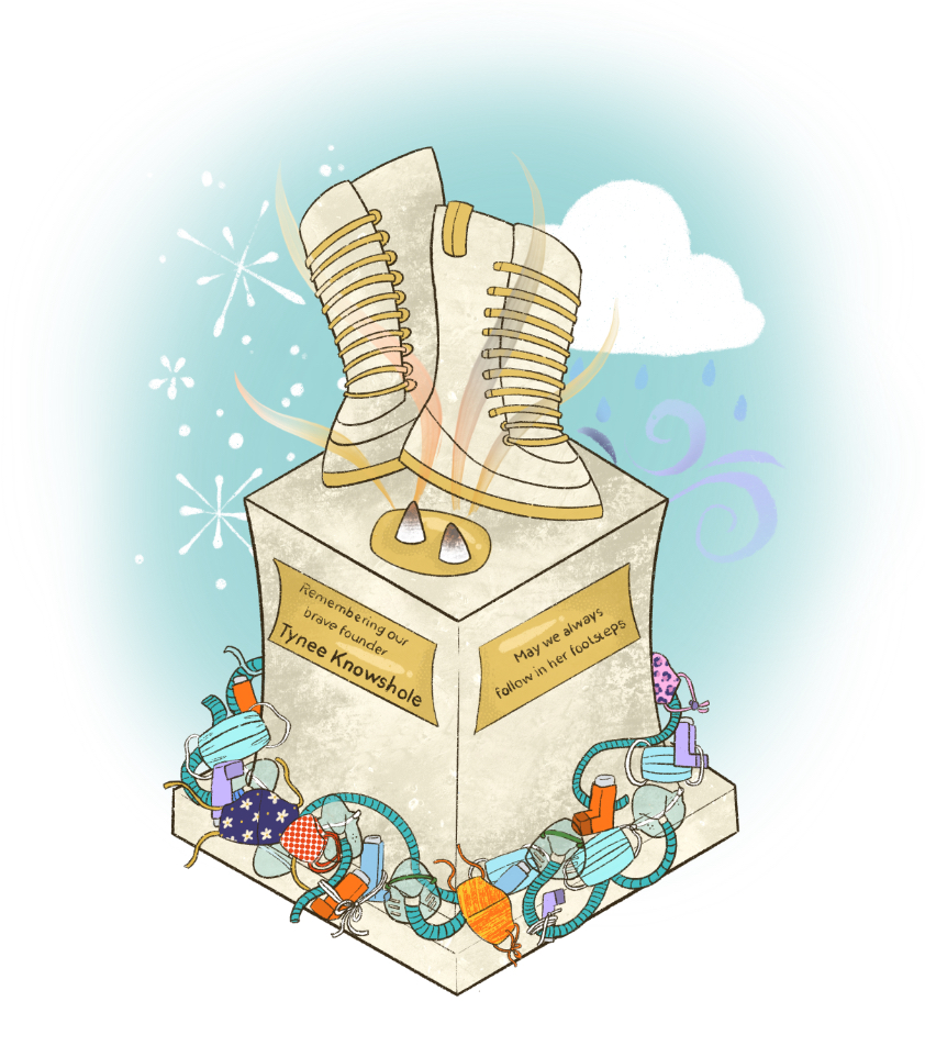 Light grey statue with two large boots on top and two gold plaques on the side